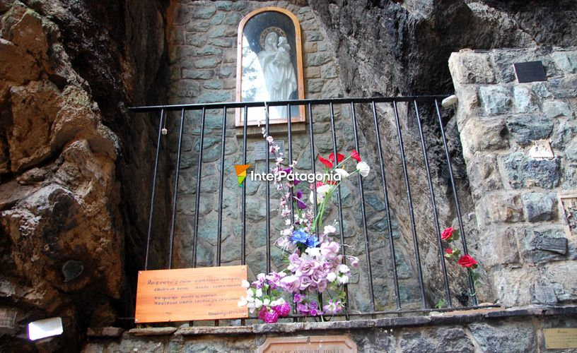The virgin stands at the top of the grotto